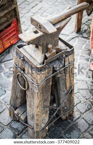 Ancient anvil used by Napoleon's army to shoe horses. - stock photo