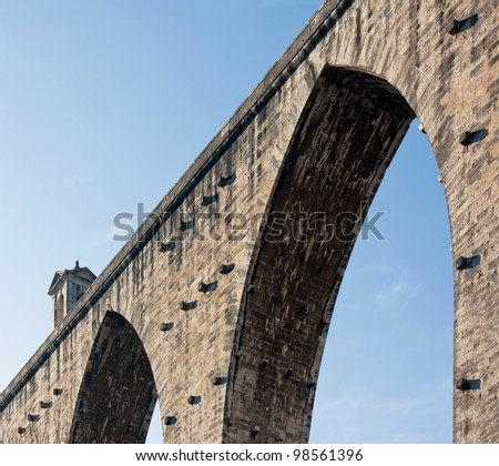 ancient aqueduct in the Lisbon built in 18th century, Portugal - stock photo
