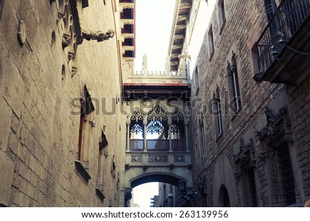 Ancient arch in Gothic quarter in Barcelona - stock photo
