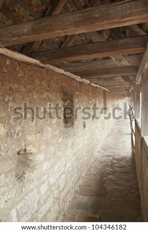 Ancient architecture corridors on castle wall in europe. - stock photo