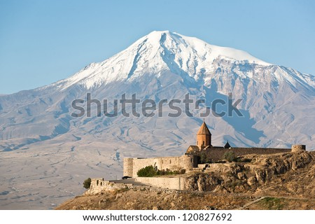 Ancient Armenian church Khor Virap with Ararat on the background. - stock photo