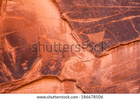 ancient art on canyon walls, Monumenti Valley - stock photo