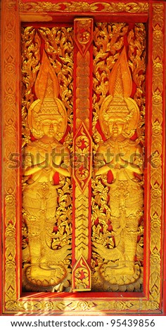 Ancient Asia statue art door background - stock photo