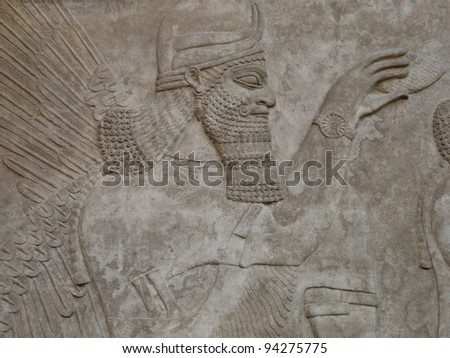 Ancient Assyrian wall carving of a man - stock photo