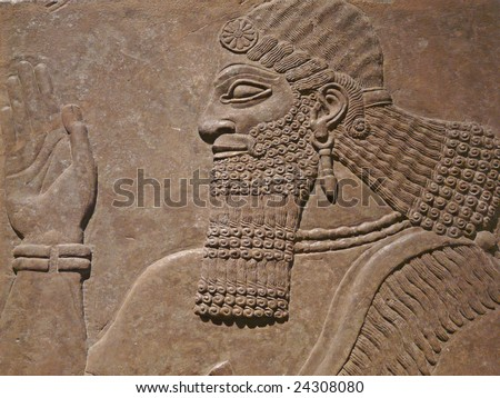 Ancient Assyrian wall carvings of a man - stock photo