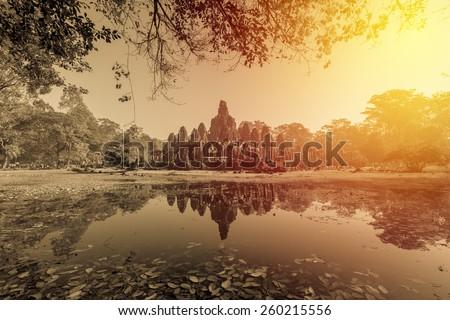 Ancient Bayon castle, Angkor Thom, Cambodia. Vintage filter. - stock photo