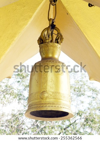 ancient bell gold color in Thailand temple. - stock photo