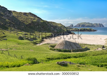 Ancient blackhouse or celtic croft preserved and restorend on a beach on Lewis in the Ouder Hebrides of Scotland - stock photo