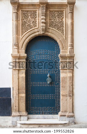 Ancient blue door with decoration. Tangier, Morocco - stock photo