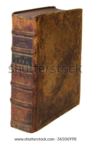 ancient book stands vertically on a white background, isolated