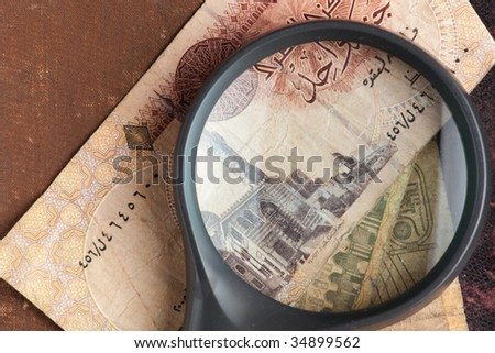 ancient book with egyptian banknotes - stock photo
