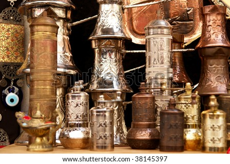 ancient brass pepper mills in souvenir shop in  Mostar, Bosnia and Herzegovina - stock photo