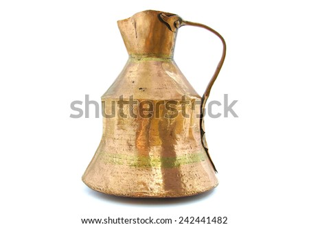 Ancient brass vessel on white background - stock photo