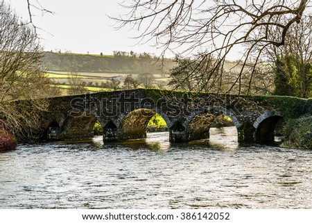 Ancient bridge over the Derry river in Ireland - stock photo