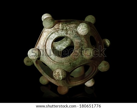 Ancient bronze Roman dodecahedron on a black background  - stock photo