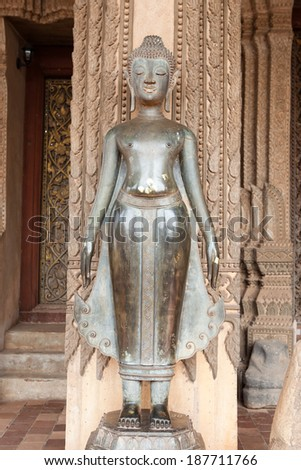 Ancient Buddha statue stands - stock photo