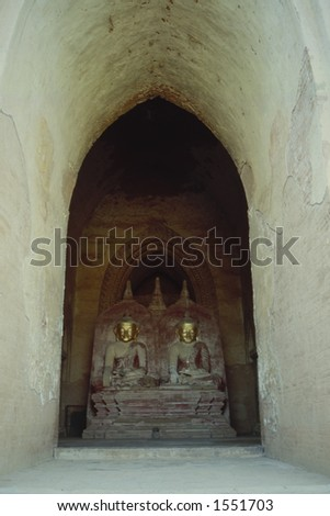 Ancient buddha statues have been erected in one of the thousands of wonderful temples in Bagan, Myanmar - stock photo