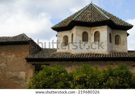 Ancient building at Spanish palace with tile roof - stock photo