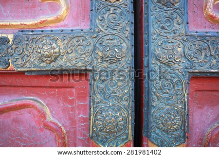 Ancient buildings of copper edge red wooden doors in the Palace Museum,Beijing China - stock photo