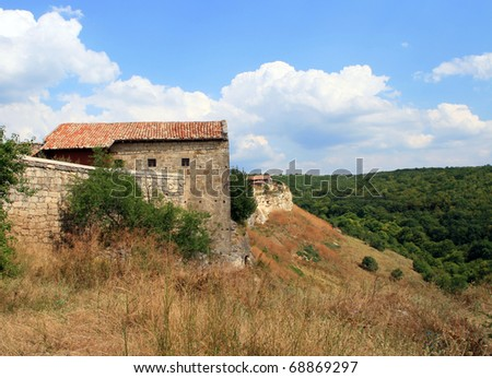 Ancient Buildings of the Chufut-Kaleh Cave Town in the Crimea - stock photo