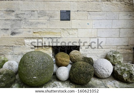 Ancient cannon balls on display in Papal Palace in Avignon, France - stock photo