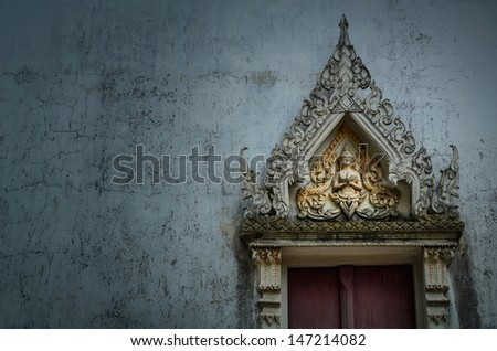 Ancient carving window of Thai temple  in Thailand - stock photo