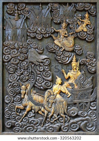 Ancient carving wooden door of Thai temple, Thailand. - stock photo