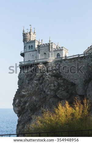 Ancient castle with towers at the edge of a cliff