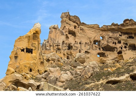 Ancient cave town in Cavusin, Cappadocia, Turkey - stock photo