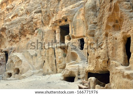 Ancient caves and catacombs in National park Little Petra, Jordan. - stock photo