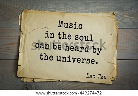 Ancient chinese philosopher Lao Tzu quote on old paper background. Music in the soul can be heard by the universe. - stock photo