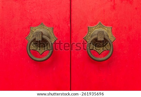 Ancient Chinese red door knocker - stock photo