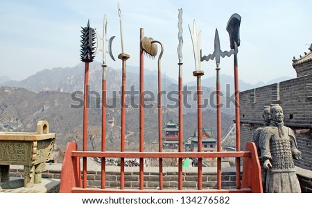 ancient  chinese spears and sculpture of terracotta soldiers on Great Wall(China) - stock photo
