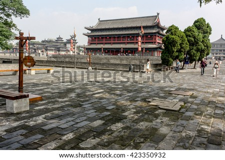 Ancient chinese tower Pagoda and the famous Xian city wall fortifications, UNESCO World Heritage, Xian, Shanxi Province, China - stock photo