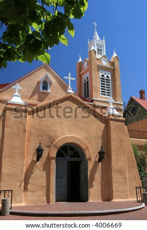 Ancient church in Albuquerque, New Mexico, built in the 1700's of adobe is symbolic of the old southwest. - stock photo