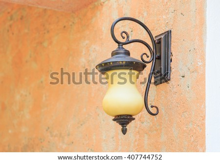ancient classic lamp on old wall