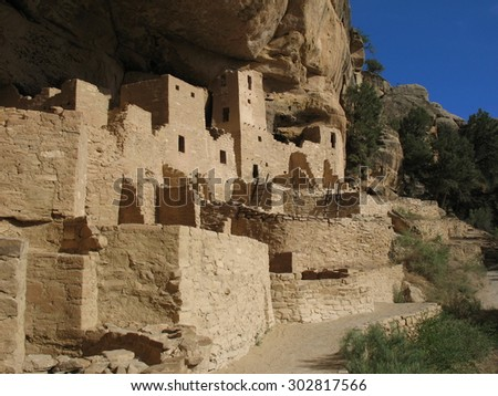 Ancient cliff dwellings - stock photo