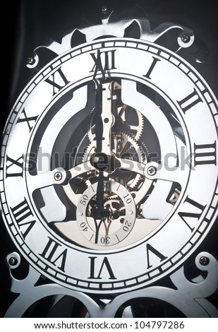 Ancient clock showing time 6 o'clock - stock photo