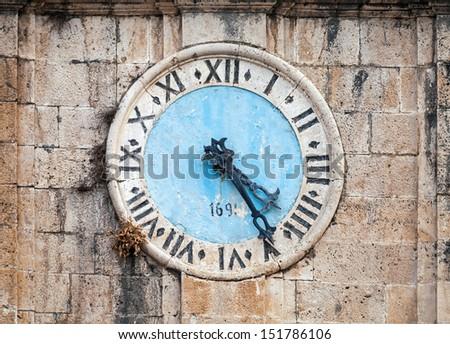 Ancient clock tower of central Saint Nicholas Church, Perast town, Montenegro - stock photo