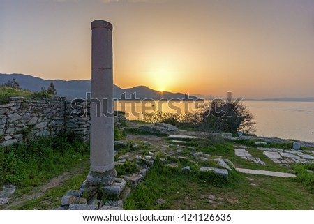 Ancient columns and sunset on Evraiokastro Archaeological Site, Thassos town, East Macedonia and Thrace, Greece  - stock photo