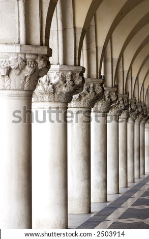 Ancient columns led down a hall to Saint Marco Square in Venice Italy