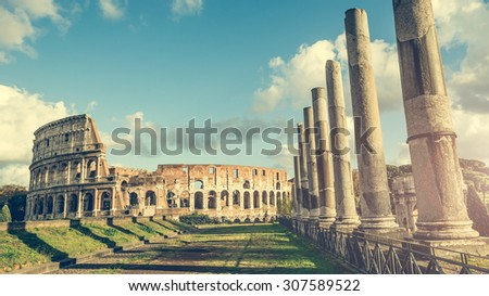 Ancient columns of the Roman temple  near the Coliseum in Rome - stock photo