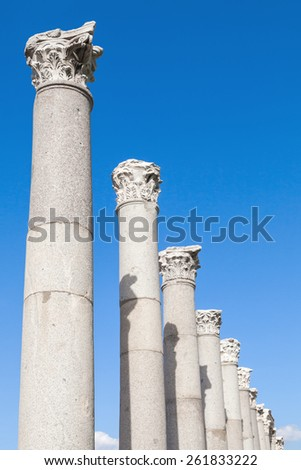 Ancient columns on blue sky background, fragment of ruined roman temple in Smyrna. Izmir, Turkey - stock photo