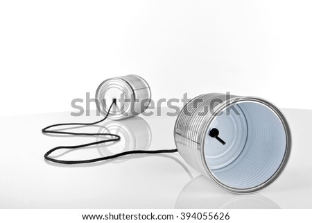 ancient communication - cans connected by string, focus on front - stock photo