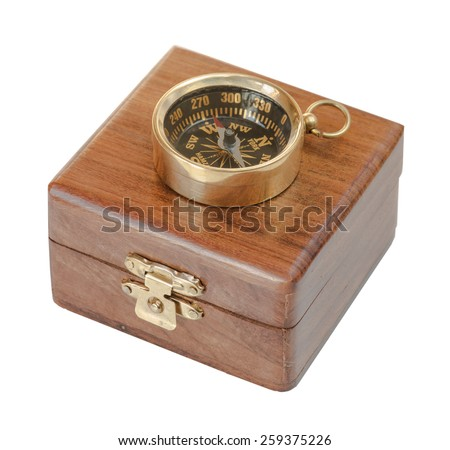 Ancient compass on a wooden case isolated on white background