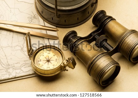 Ancient compass on the map - stock photo