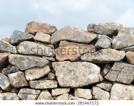 Ancient Cornish dry stone wall close up. - stock photo