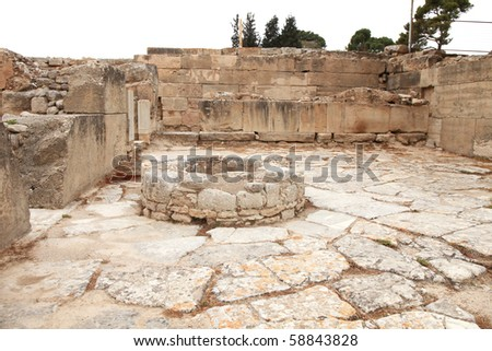 Ancient courtyard with waterwell in Phaistos - stock photo