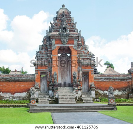 ancient decorated hindu temple gates in Bali, Indonesia - stock photo