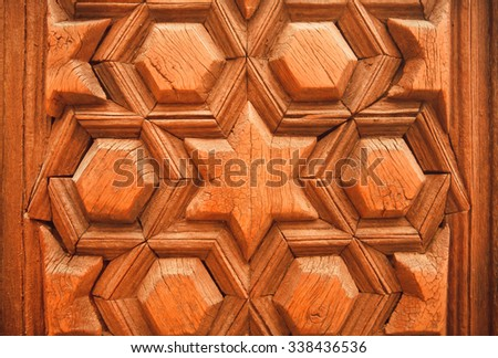 Ancient design with islamic patterns on historical wooden door, Syrian house - stock photo